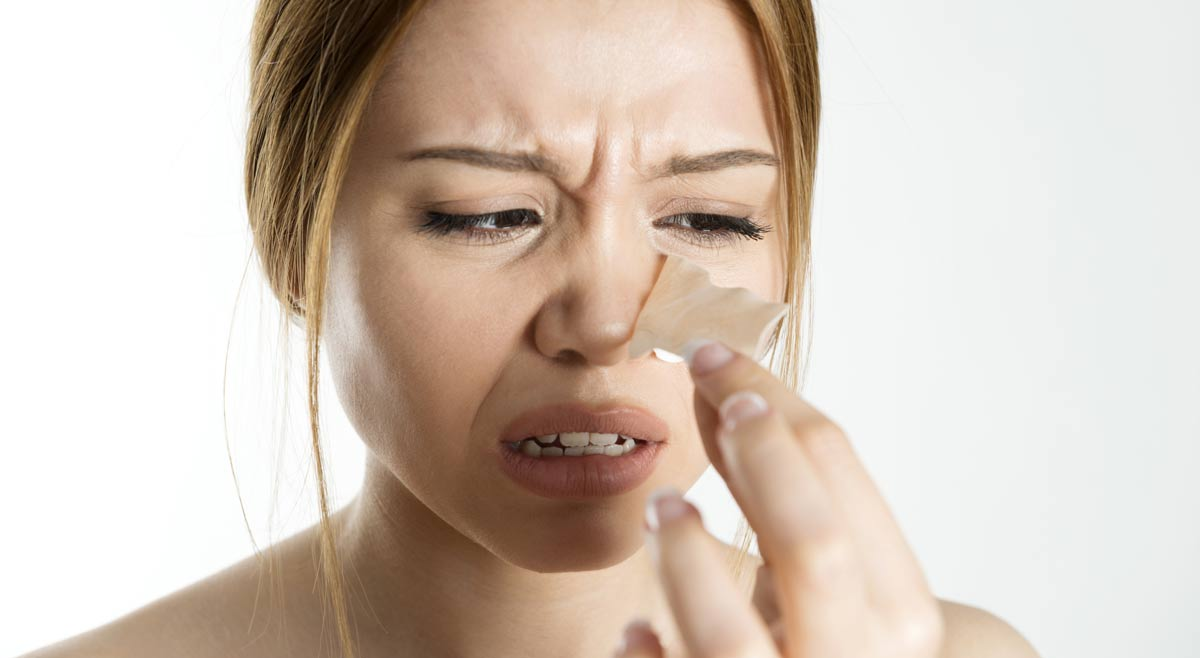 Woman frustrated with nasal strips